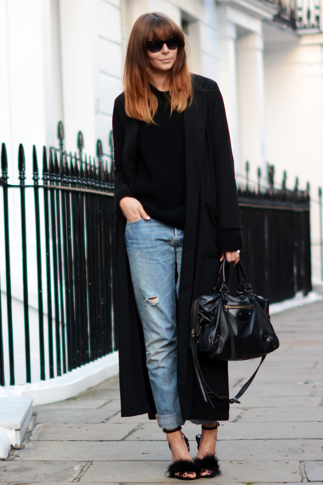 EJSTYLE - Long Black boohoo duster coat, levis 501 boyfriend jeans, Boohoo black funnel neck jumper, Missguided black fluffy feather Carrie heels sandals, Balenciaga motorcycle le dix city bag black