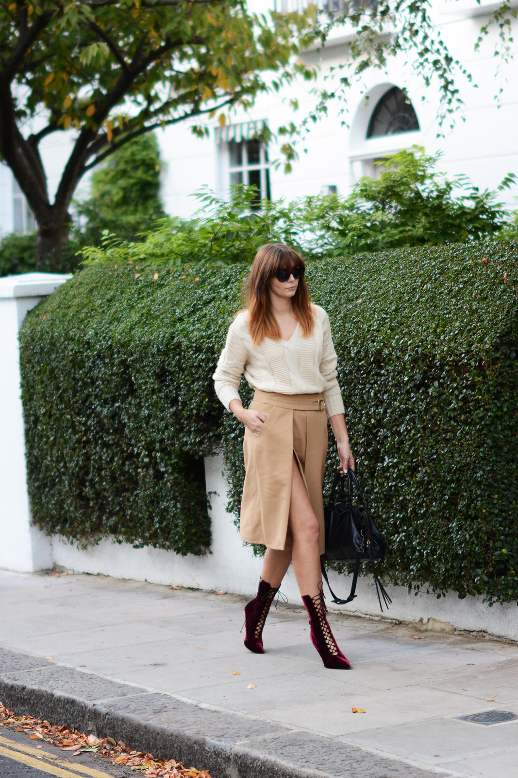 EJSTYLE - OOTD Zara Camel wrap skirt with buckles, chunky cream knitted sweater jumper, Balenciaga motorcycle le dix bag, Kurt Geiger lace up velvet boots metal heel, cat eye sunglasses