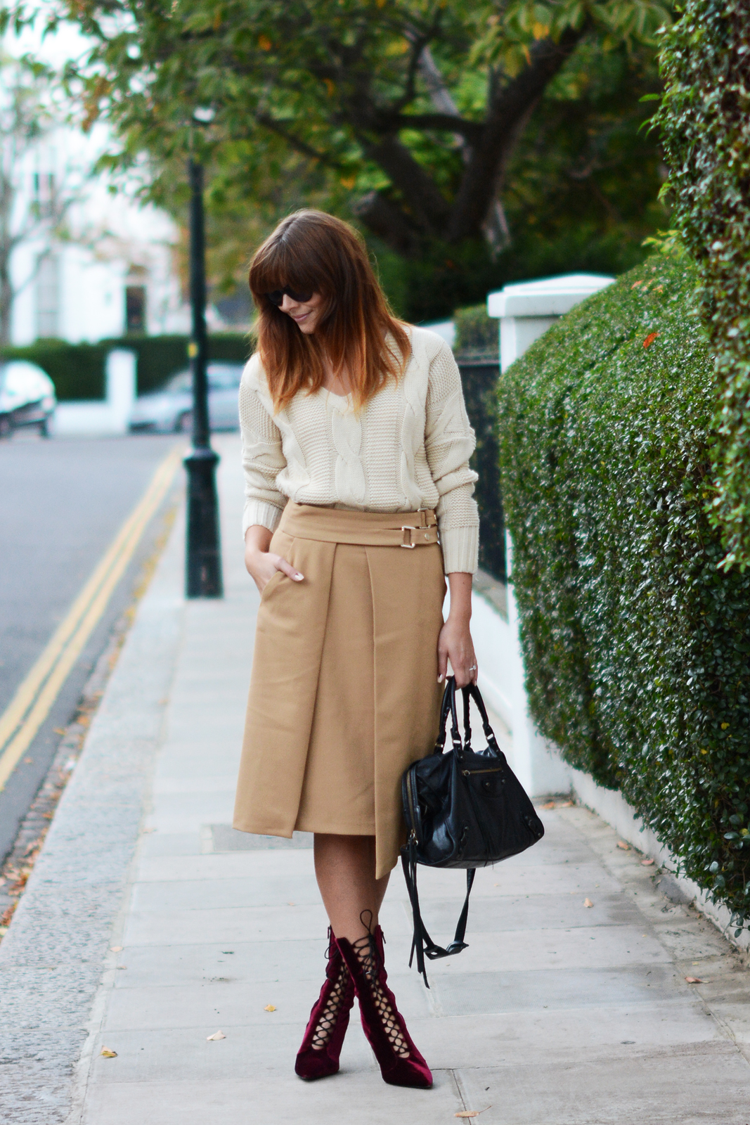 EJSTYLE - OOTD Zara Camel wrap skirt with buckles, chunky cream knitted sweater jumper, Balenciaga motorcycle le dix bag, Kurt Geiger lace up velvet boots metal heel