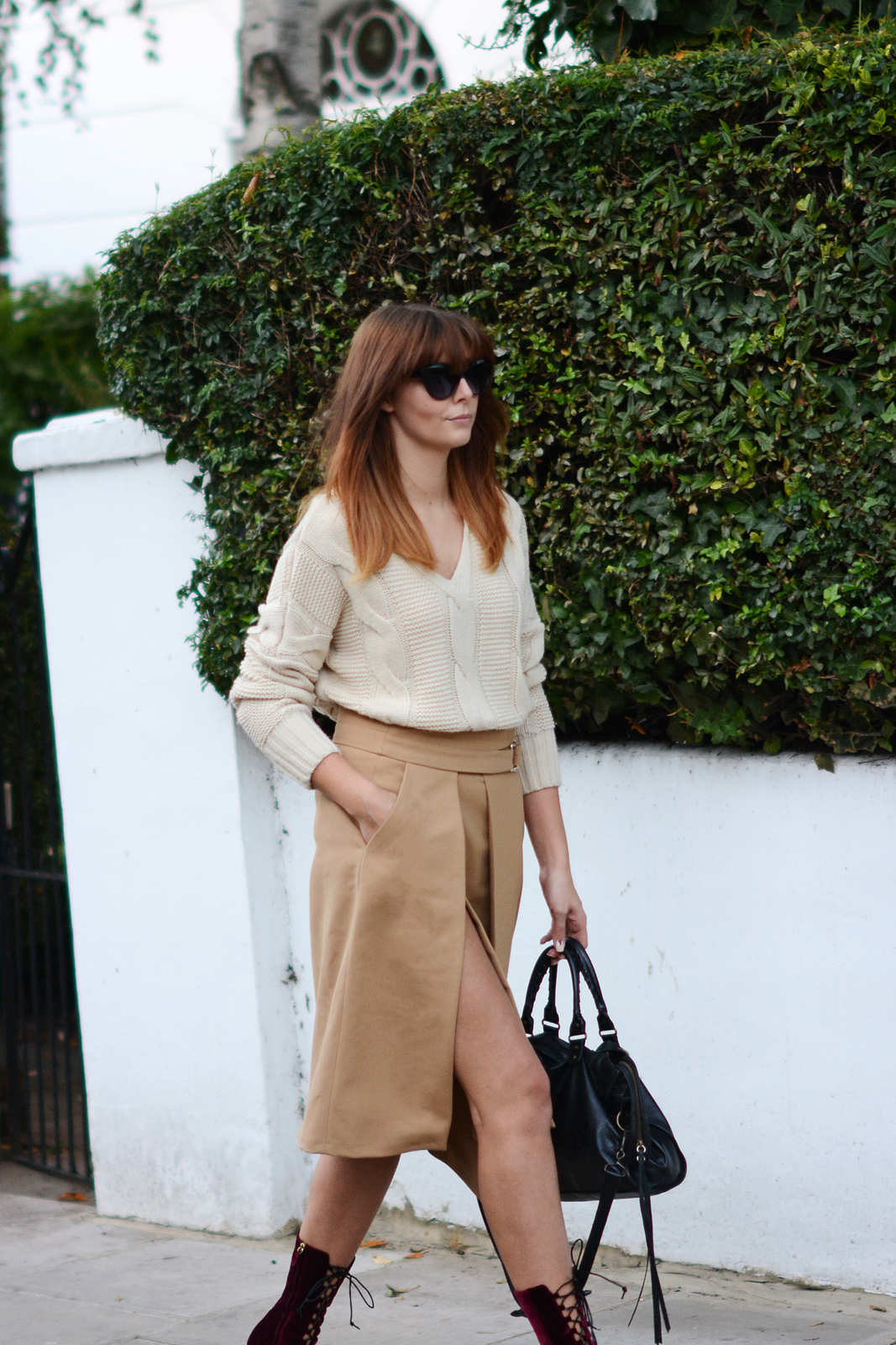 EJSTYLE - OOTD Zara Camel wrap skirt with buckles, chunky cream knitted sweater jumper, Balenciaga motorcycle le dix bag, burgundy velvet boots, cat eye sunglasses