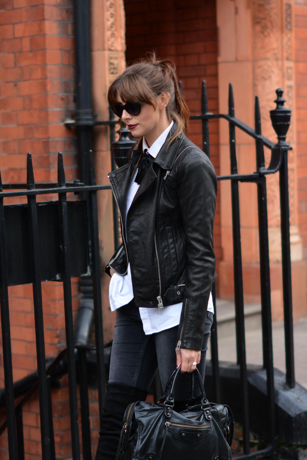 EJSTYLE - Black bowtie, all saints leather biker jacket, white shirt, black acid wash skinny jeans, OTK boots, Balenciaga city bag