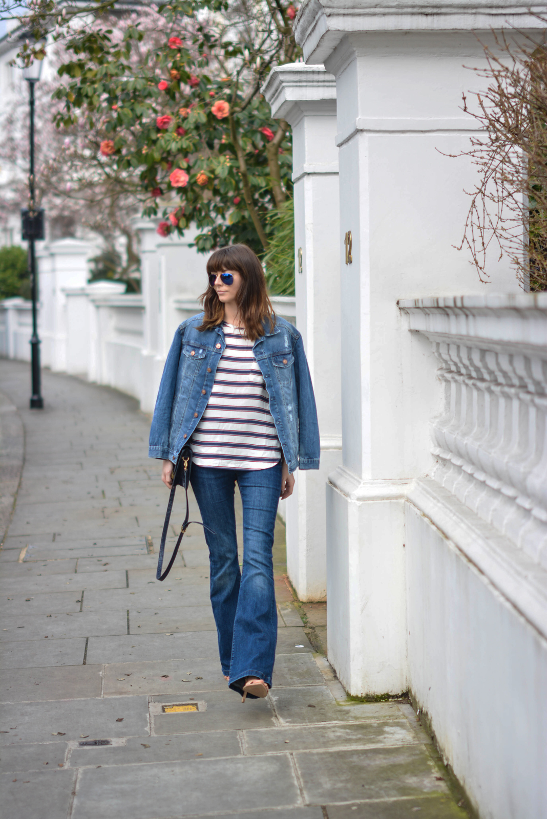 EJSTYLE - Emma Hill, Double denim, Spring outfit, flare jeans, stripe H&M top, H&M denim jacket, navy bag, nude sandals, OOTD, street style, polarised ray-bans