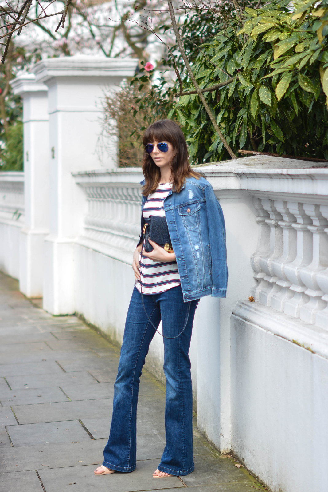 EJSTYLE - Emma Hill, Double denim, Spring outfit, flare jeans, stripe H&M top, H&M denim jacket, navy bag, nude sandals, OOTD