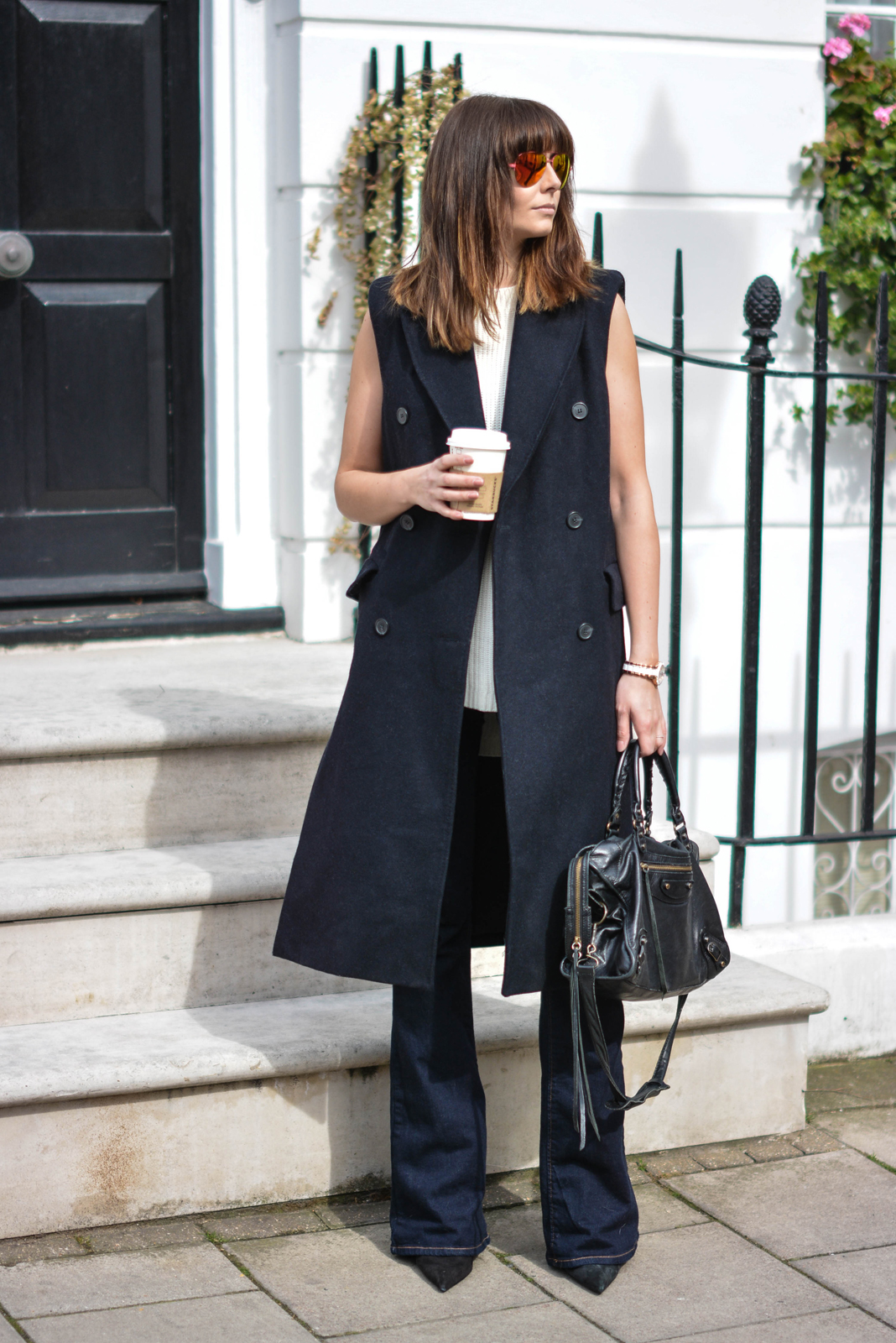 EJSTYLE - Emma Hill, H&M Studio sleeveless coat, flare jeans, Kurt Geiger aviator sunglasses, Balenciaga le city bag, Pointed black suede court shoes heels, spring style, OOTD