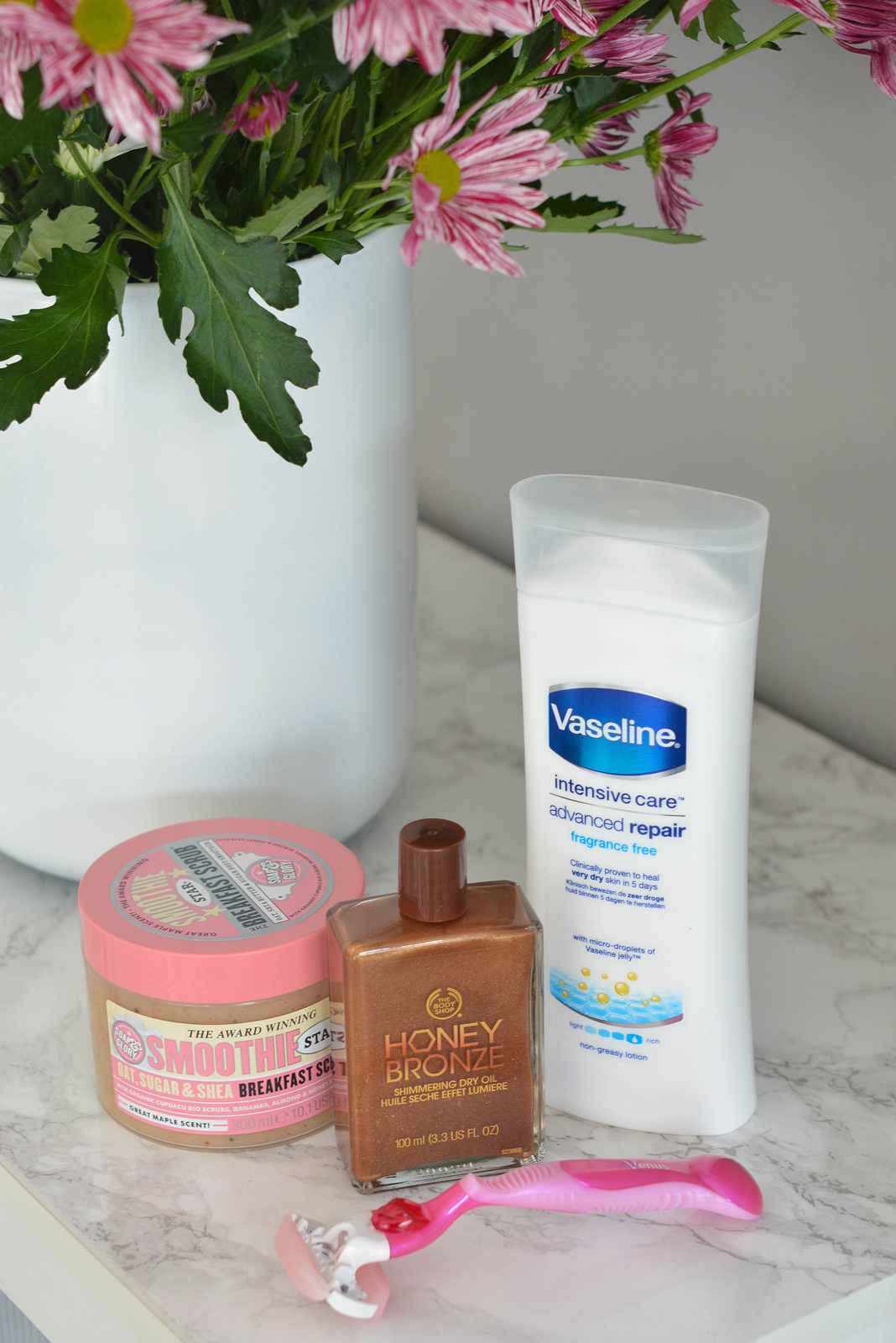 EJSTYLE - Emma Hill, beauty blogger, summer ready legs, legs skincare routine, summer legs, vaseline intensive repair lotion, body shop honey shimmer oil, soap & glory breakfast scrub, Gillette venus breeze razor