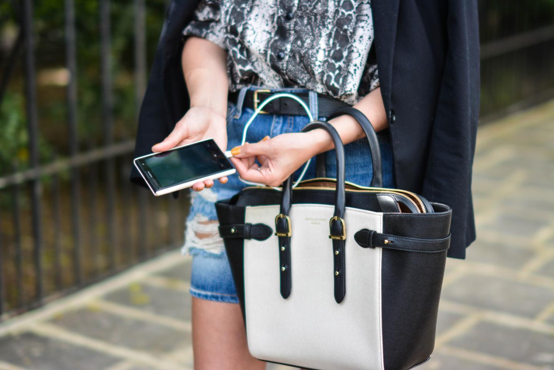 EJSTYLE - Aspinal phone charging bag, snakskin print shirt, black blazer, denim mini skirt