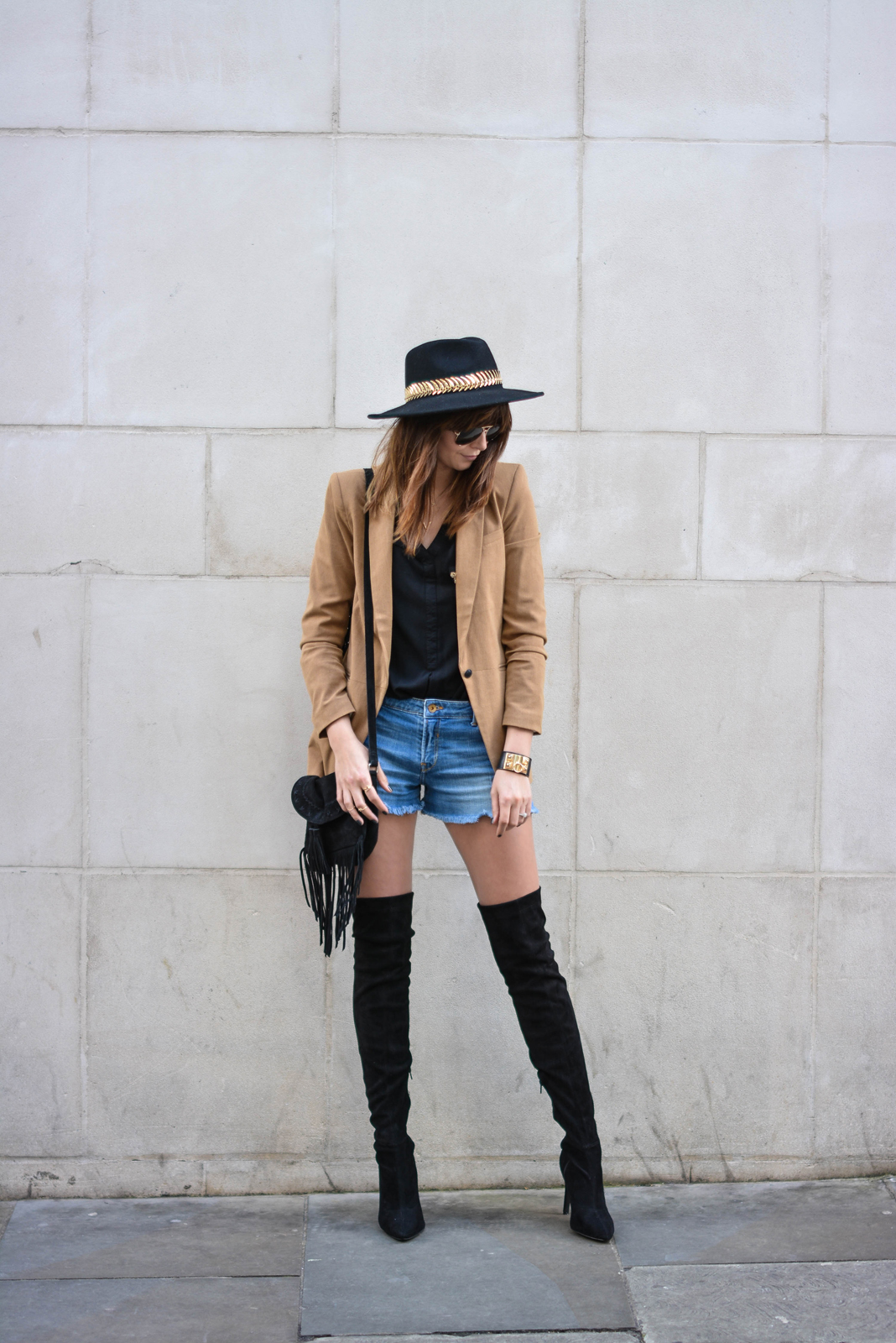 EJSTYLE - Emma Hill wearing Camel blazer, black shirt, black suede thigh high OTK boots, Fedora hat, denim shorts, black suede fringe tassel bag, collier de chien cuff bracelet, aviator sunglasses, OOTD