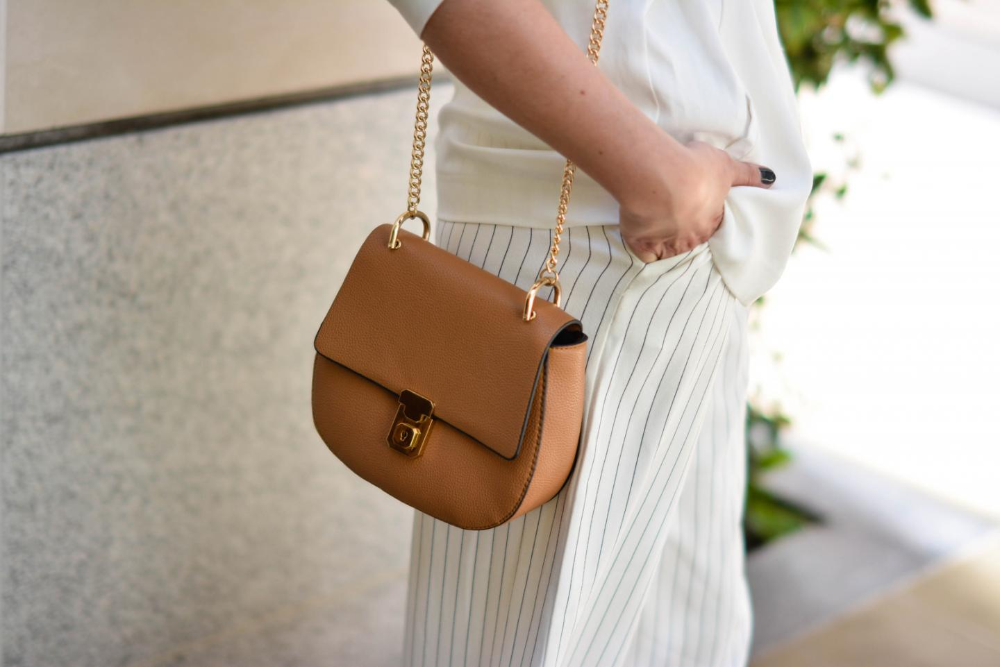 EJSTYLE - Emma Hill wearing Gestuz white wrap jacket, Finders Keepers white pinstripe culottes, tan Chloe drew dupe inspired bag