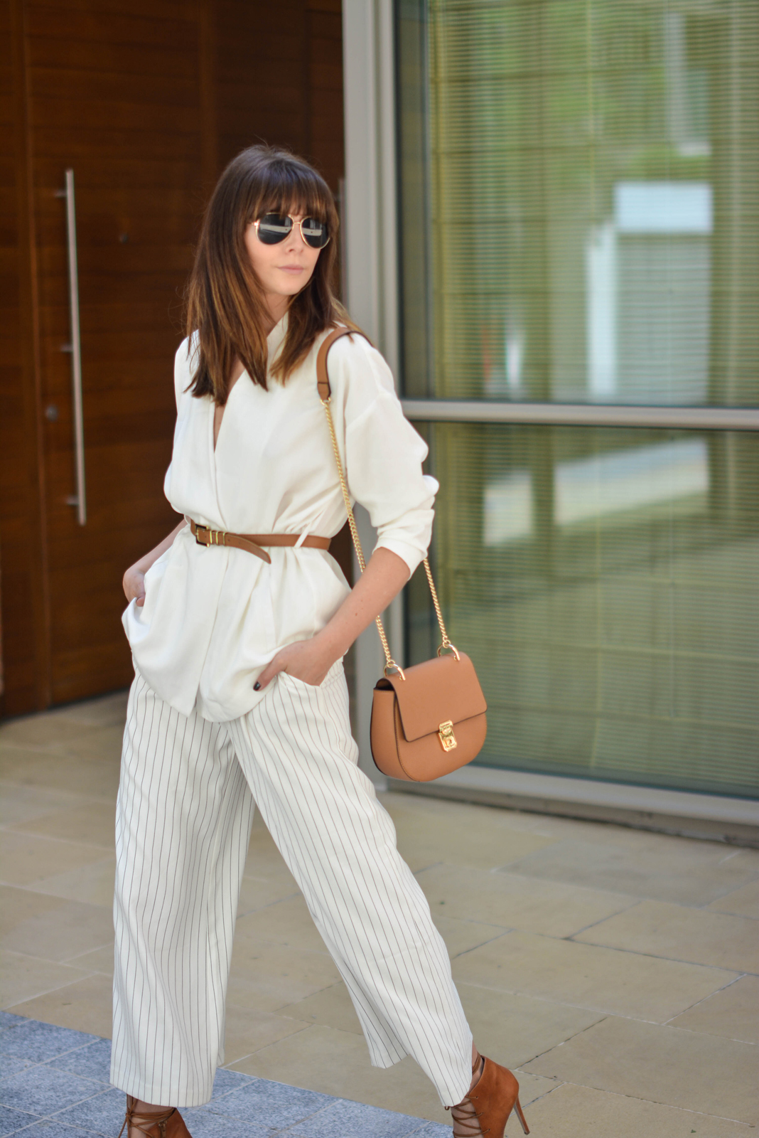 EJSTYLE - Emma Hill wearing Gestuz white wrap jacket, tan skinny waist belt, Finders Keepers white pinstripe wide leg culottes, Tan Chloe 'drew' dupe bag, aviator sunglasses