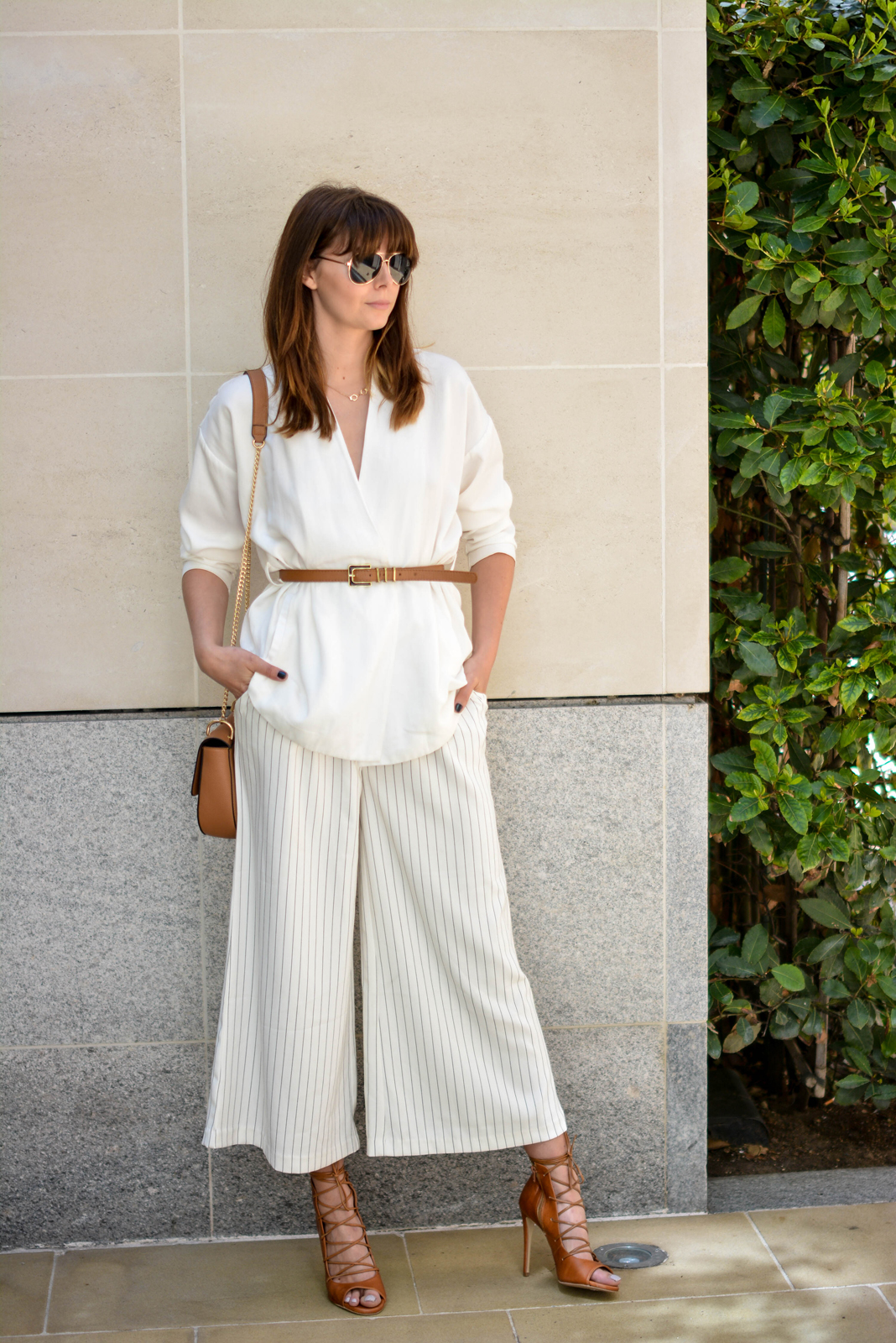 EJSTYLE - Emma Hill wearing Gestuz white wrap jacket, tan skinny waist belt, Finders Keepers white pinstripe wide leg culottes, Tan Chloe 'drew' dupe bag, tan lace up heels, summer whites outfit, ootd