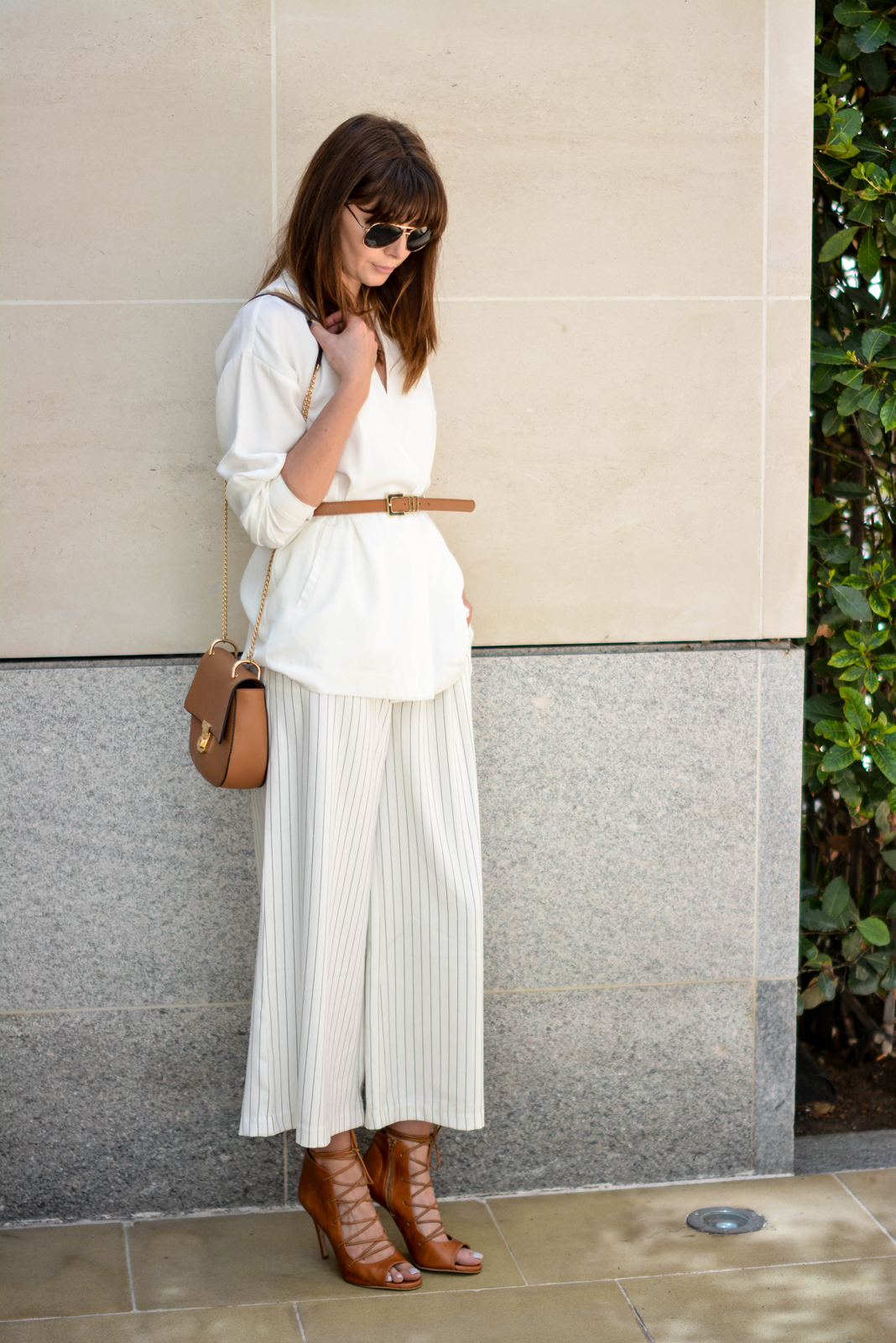 EJSTYLE - Emma Hill wearing Gestuz white wrap jacket, tan skinny waist belt, Finders Keepers white pinstripe wide leg culottes, Tan Chloe 'drew' dupe bag, tan lace up heels, summer whites outfit