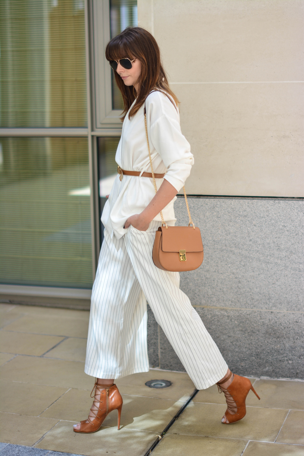 EJSTYLE - Emma Hill wearing Gestuz white wrap jacket, tan skinny waist belt, Finders Keepers white pinstripe wide leg culottes, Tan Chloe 'drew' dupe bag, tan lace up heels