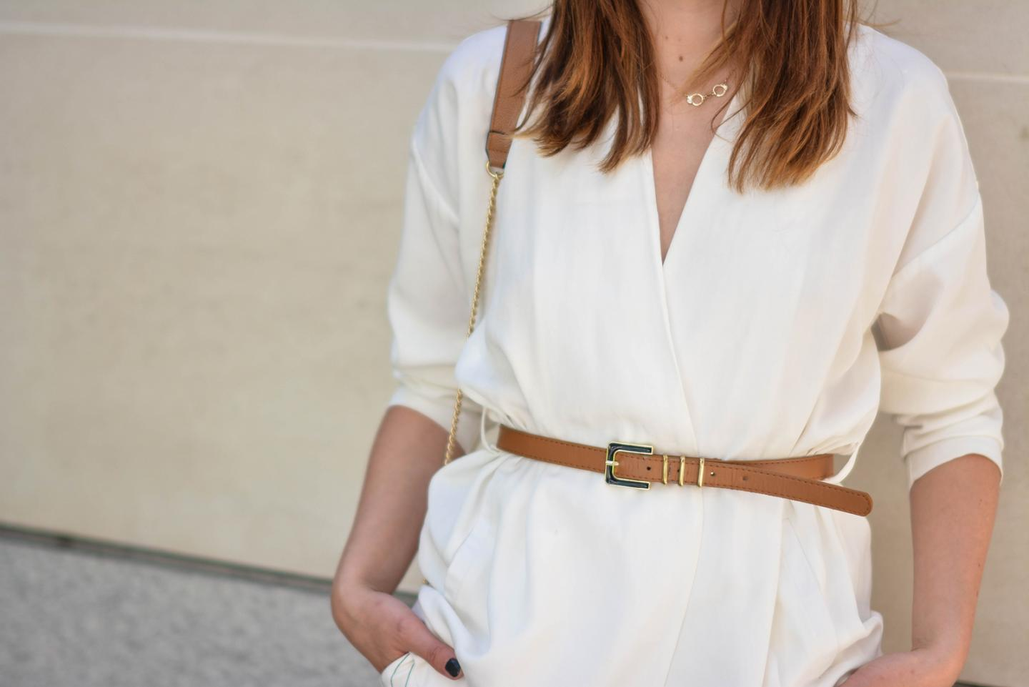EJSTYLE - Emma Hill wearing Gestuz white wrap jacket, tan skinny waist belt, gold handcuff necklace