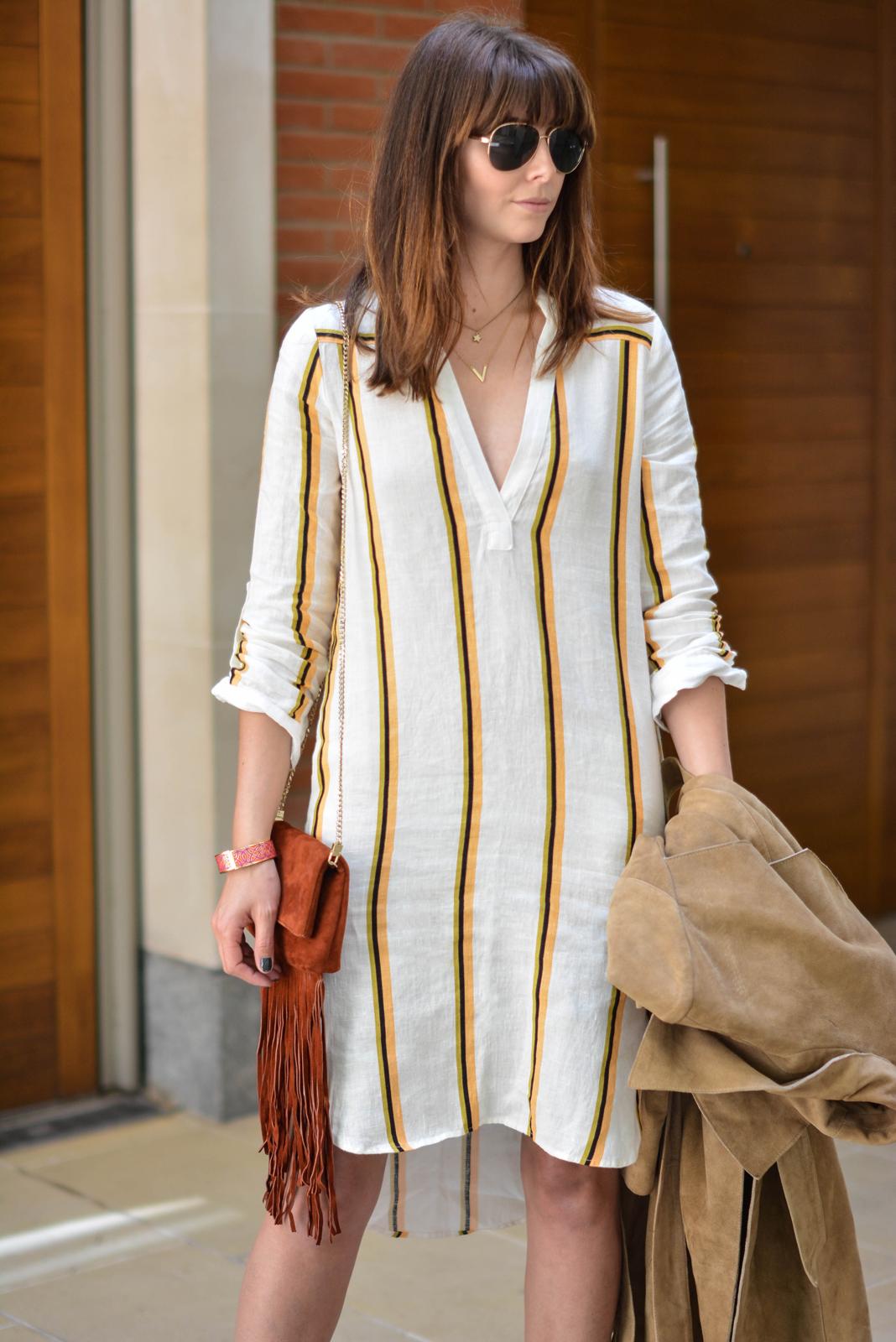 EJSTYLE - Emma Hill wears H&M linen stripe shirt dress, Gestuz suede trench coat, gold aviator sunglasses, Karen Millen suded fringe bag, OOTD