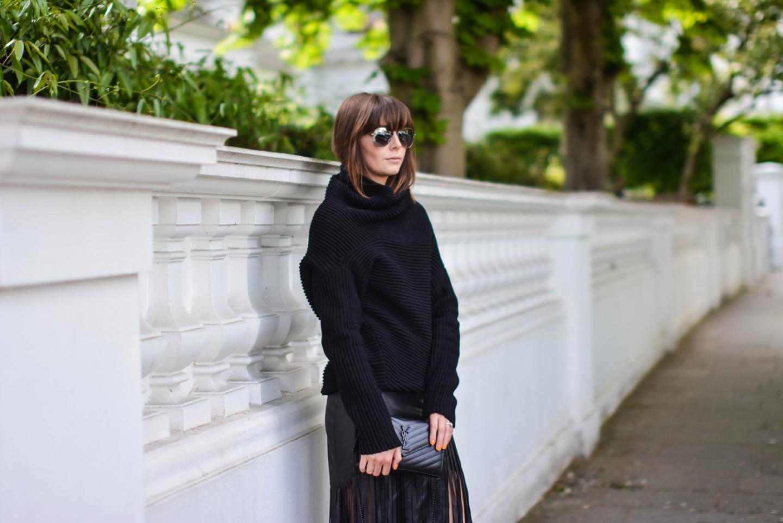 EJSTYLE - Emma Hill wears River Island faux leather fringe tassel skirt, Romwe black jumper, YSL quilted envelope clutch bag, all black OOTD, street style