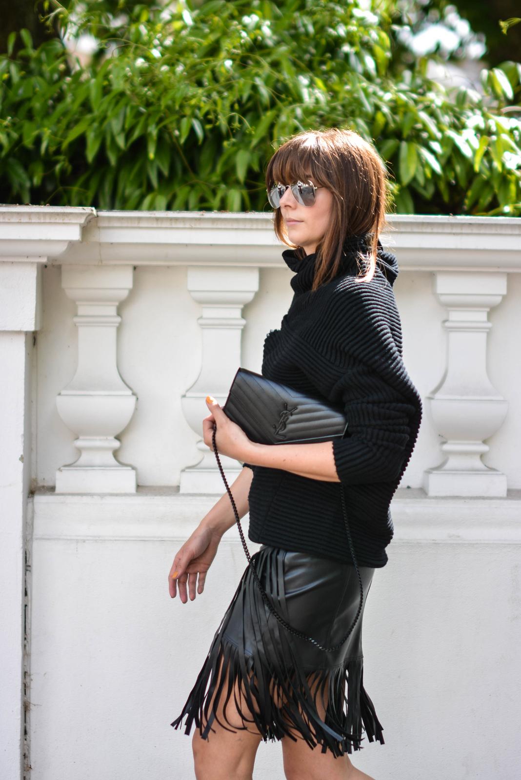 EJSTYLE - Emma Hill wears River Island faux leather fringe tassel skirt, Romwe black jumper, YSL quilted envelope clutch bag, all black OOTD