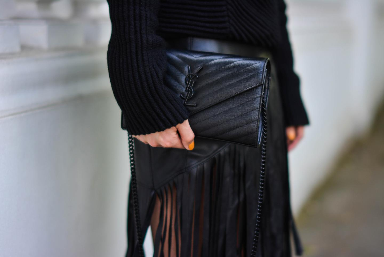 EJSTYLE - Emma Hill wears River Island faux leather fringe tassel skirt, Romwe black jumper, YSL quilted envelope clutch bag, all black outfit