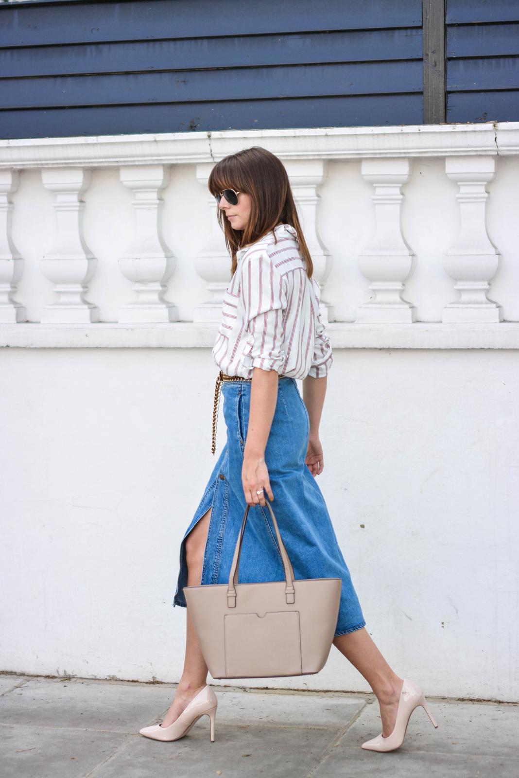 EJSTYLE - Emma Hill wears Zara denim a line button midi skirt, Zara 70s stripe shirt, Nude pointed court shoes, Mango beige tote bag, tan suede gold chain belt, OOTD, street style