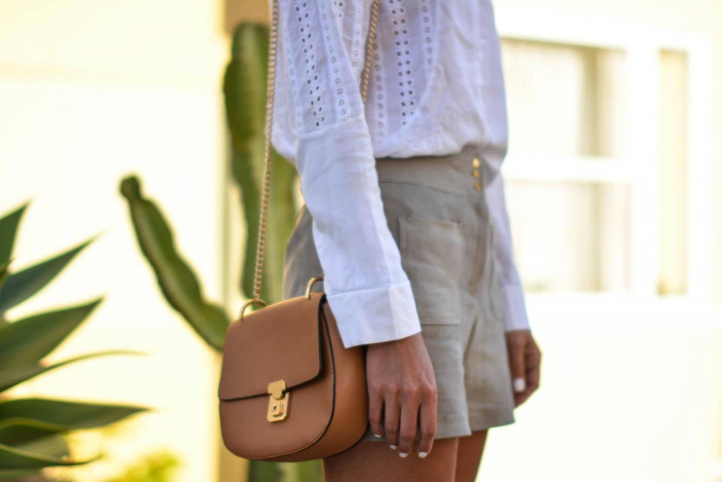 EJSTYLE - Emma Hill wears white broderie anglais shirt, M&S faux suede front pocket shorts, Forever 21 Tan shoulder bag similar to chloe 'Drew', SS15