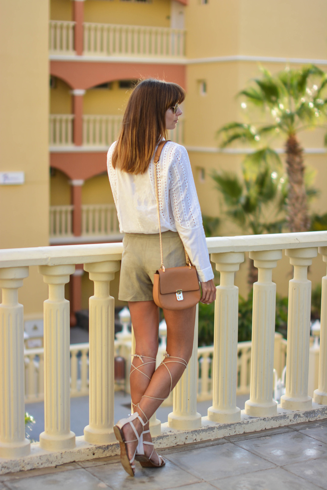 EJSTYLE - Emma Hill wears white broderie anglais shirt, M&S faux suede shorts, Mango tie up gladiator sandals, Forever 21 Chloe Drew dupe bag, Summer style, SS15
