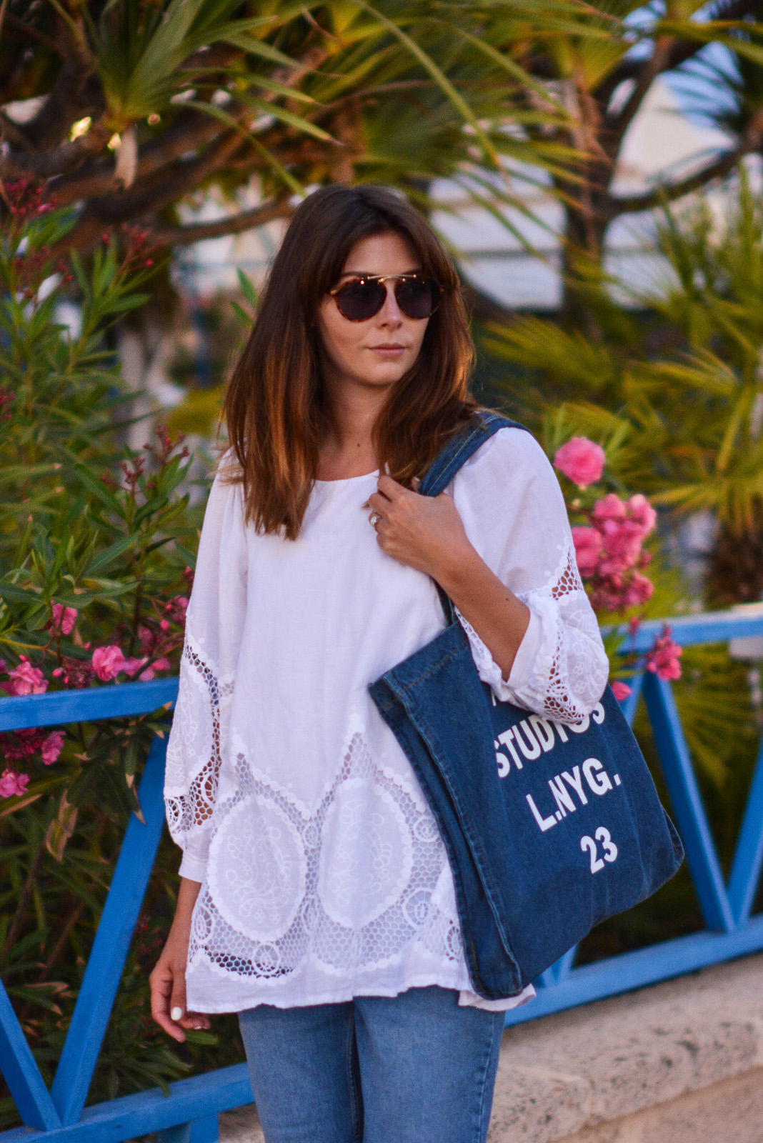 EJSTYLE - Emma Hill wears Acne Studios printed denim tote bag, white summer top with cut out embroidered detail, ASOS thea girlfriend jeans, asos round bridge 70s sunglasses