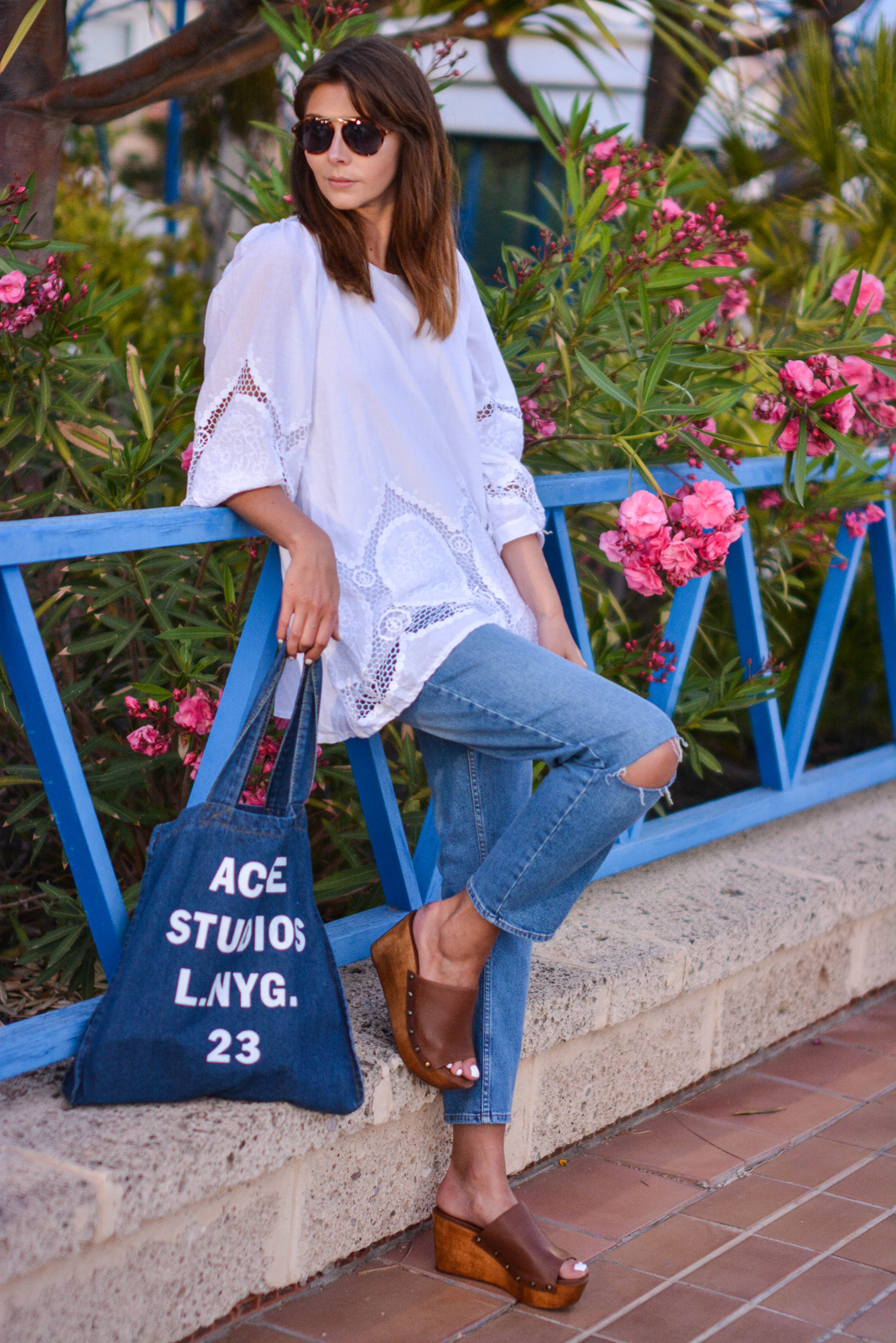 EJSTYLE - Emma Hill wears Acne Studios printed denim tote bag, white summer top with cut out embroidered detail, mASOS thea girlfriend jeans, Dune Keera wedge sandals, Asos aviator sunglasses, OOTD, summer style