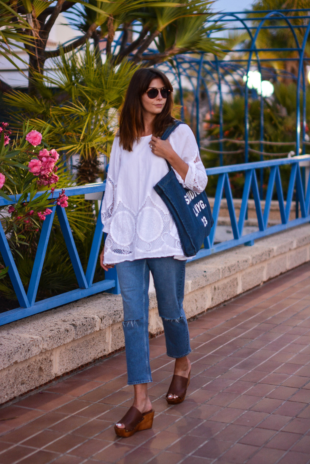 EJSTYLE - Emma Hill wears Acne Studios printed denim tote bag, white summer top with cut out embroidered detail, mASOS thea girlfriend jeans, Dune Keera wedge sandals, Asos aviator sunglasses, OOTD
