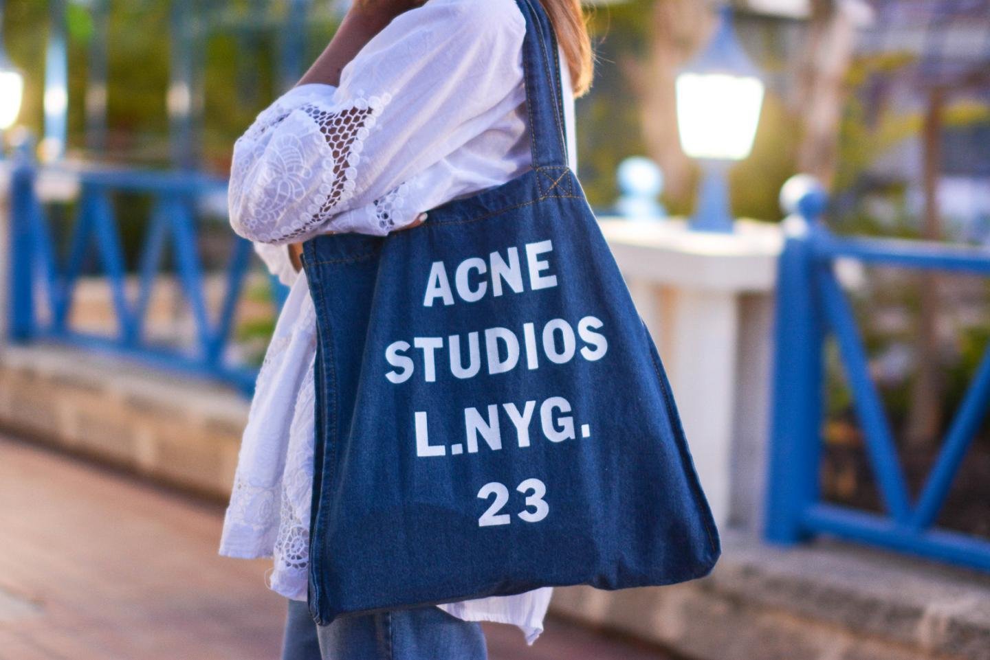 EJSTYLE - Emma Hill wears Acne Studios printed denim tote bag, white summer top with cut out embroidered detail