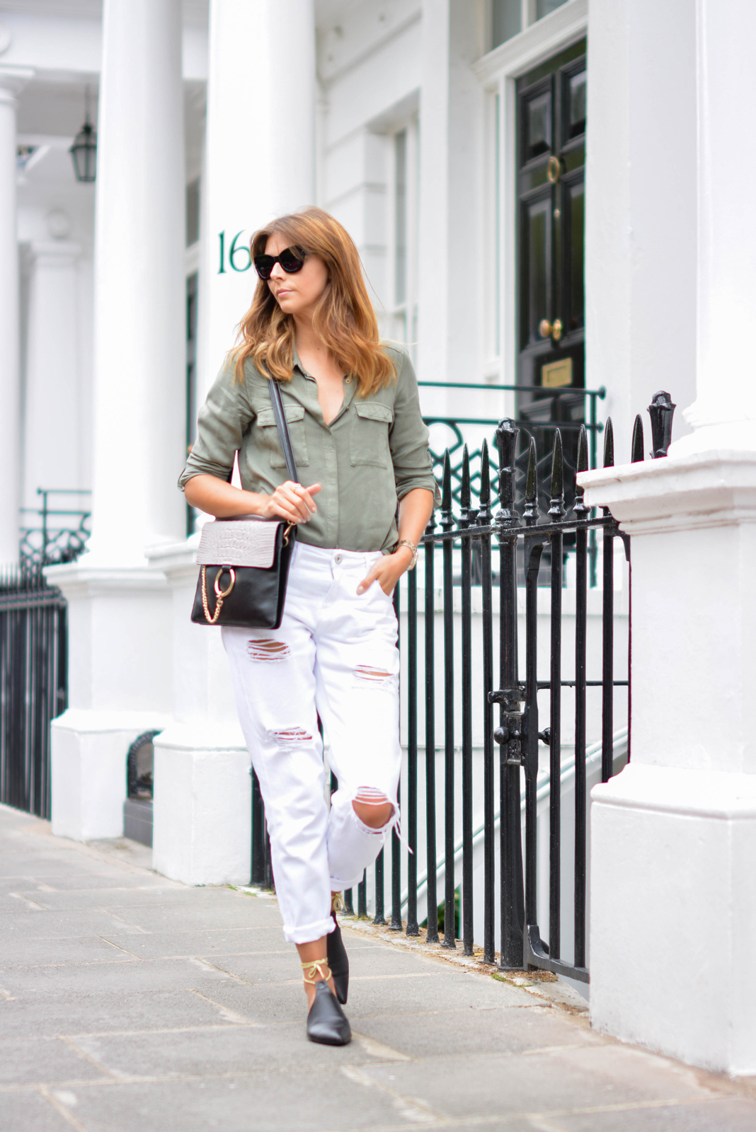 EJSTYLE - Emma Hill wears Chloe Faye dupe style bag, white ripped boyfriend jeans, khaki shirt, chanel style black mules flat shoes with gold ankle ties, chunky black cats eye sunglasses, OOTD, street style