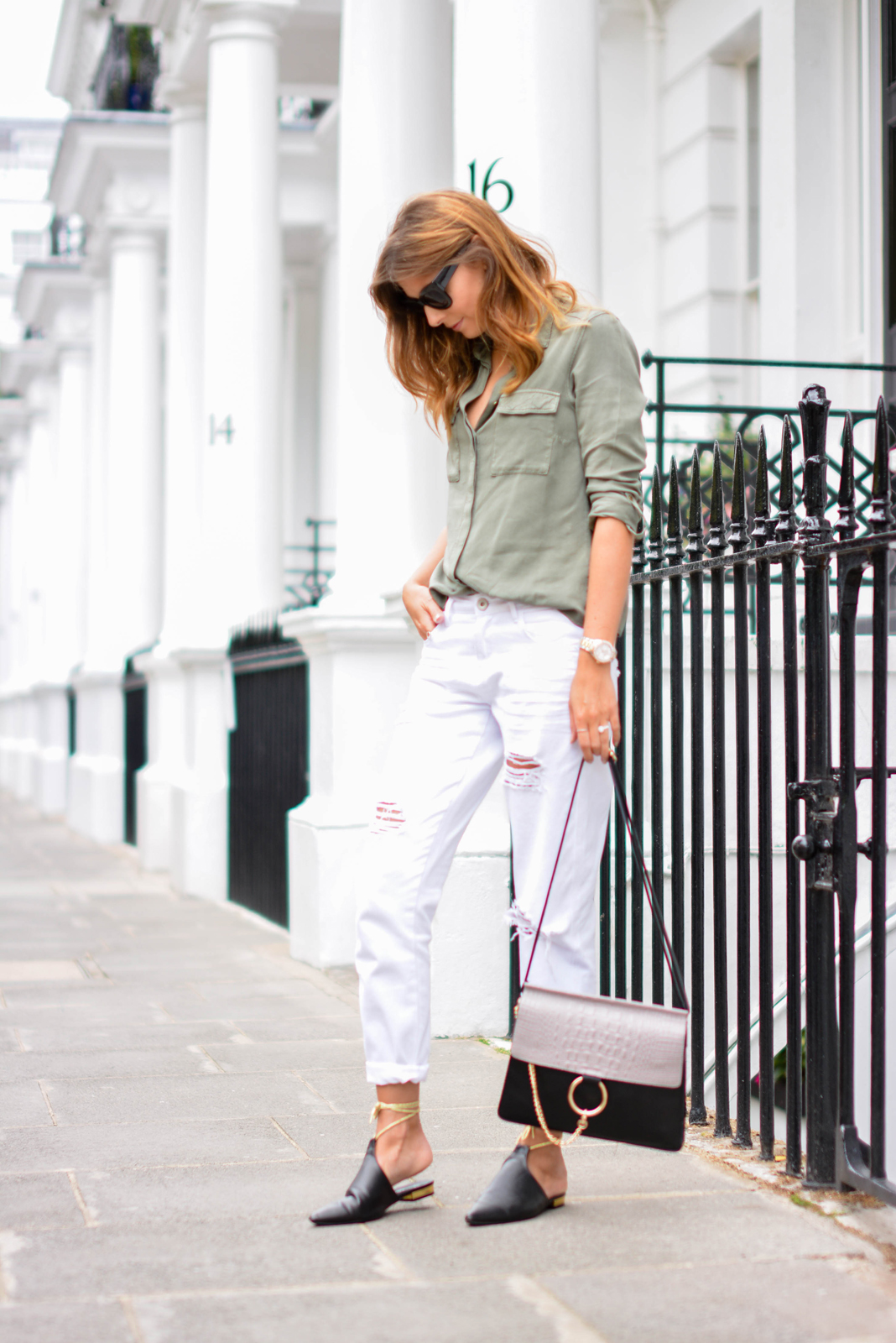 EJSTYLE - Emma Hill wears Chloe Faye dupe style bag, white ripped boyfriend jeans, khaki shirt, chanel style black mules flat shoes with gold ankle ties, chunky black cats eye sunglasses, OOTD