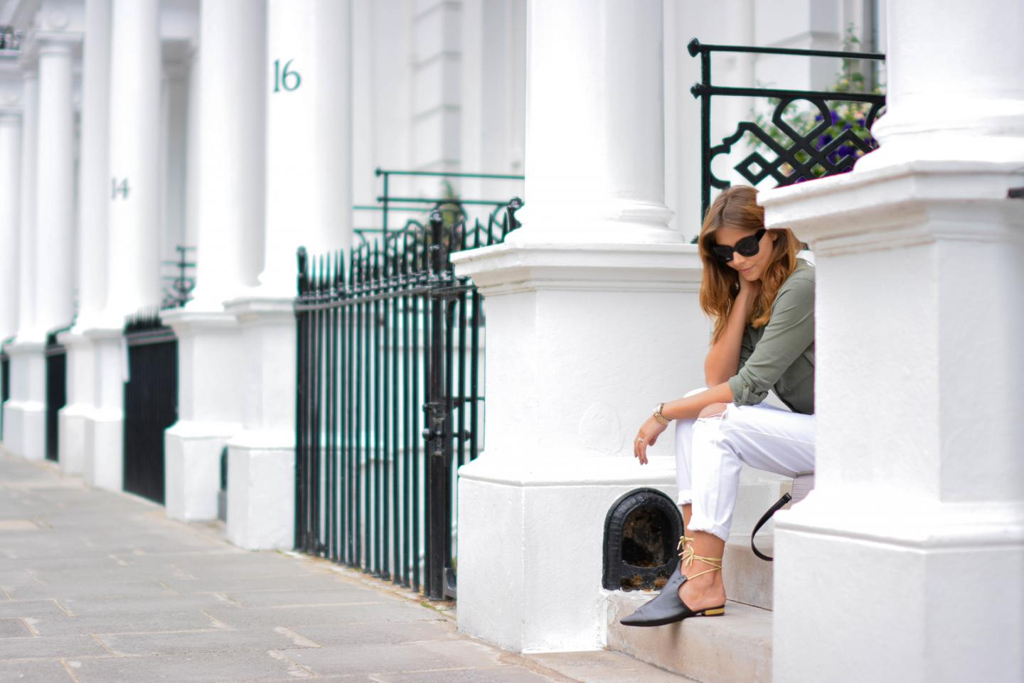 EJSTYLE - Emma Hill wears Monica Vinader rose gold diamond hoop ring, Chloe Faye dupe style bag, white ripped boyfriend jeans, khaki shirt, black gold ankle tie chanel style mules flats