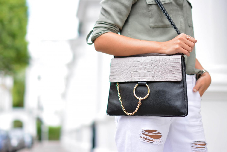 EJSTYLE - Emma Hill wears Monica Vinader rose gold diamond hoop ring, Chloe Faye dupe style bag, white ripped boyfriend jeans, khaki shirt