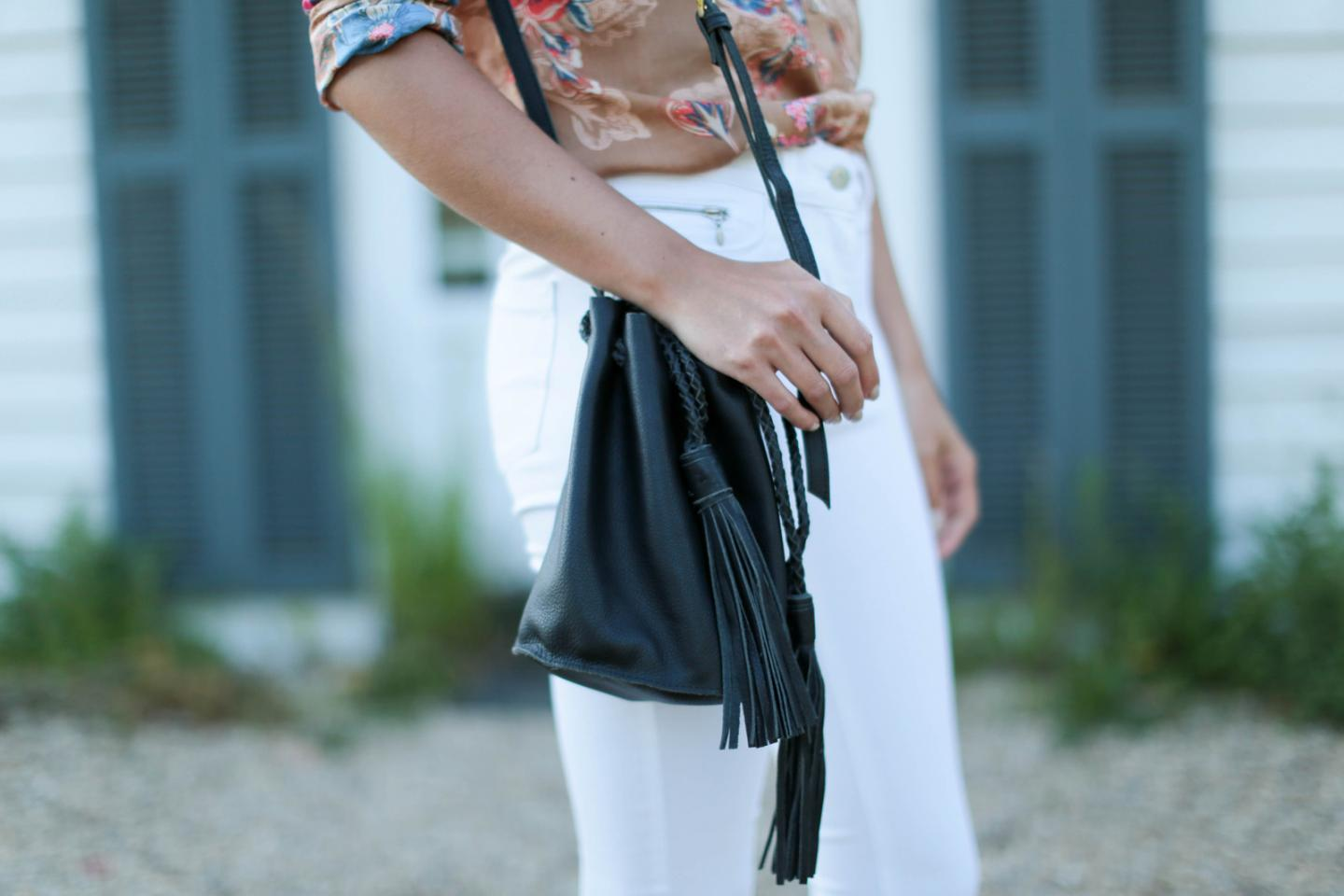 EJSTYLE - Emma Hill wears Next black tassel bucket bag, 70s retro floral print shirt, white skinny jeans