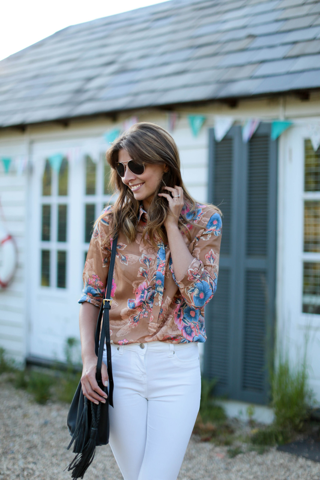 EJSTYLE - Emma Hill wears Next white skinny jeans, 70s retro floral print shirt, aviator sunglasses, black bucket bag with tassel tie, OOTD, Nextbloggerisland