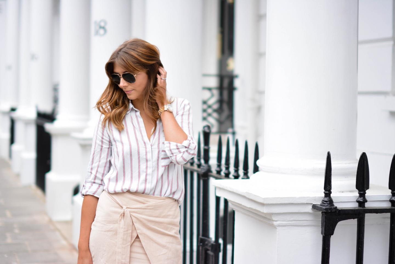 EJSTYLE - Emma Hill wears Zara stripe shirt, beige wrap skirt, aviator sunglasses, london street style
