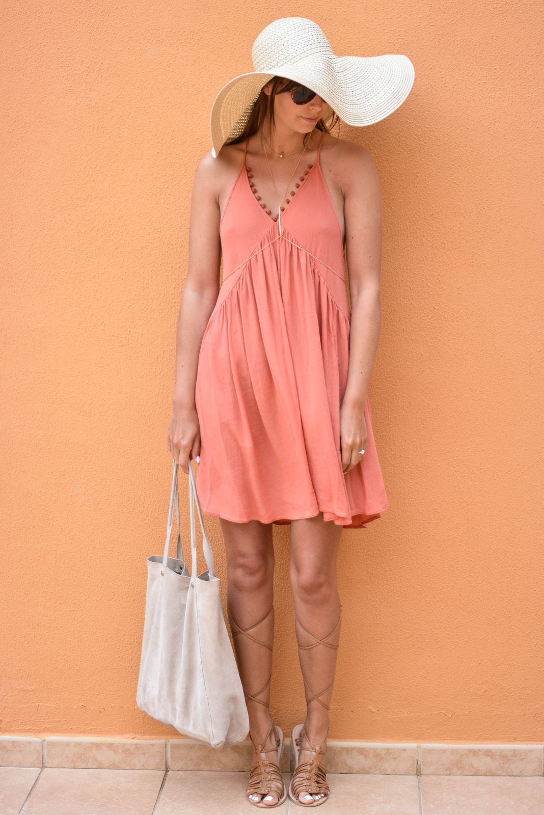 EJSTYLE - Emma Hill wears asos terracotta pom pom trim summer dress, large asos floppy straw sun hat, ASOS tan grecian gladiator sandals, ASOS beige suede bag, asos gold body harness, asseenonme