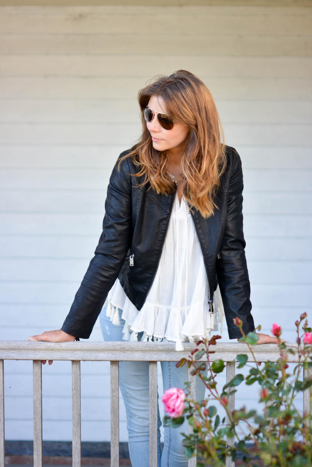 EJSTYLE - Emma Hill wears black tassel fringe leather jacket, tassel trip tunic top, bleach wash skinny jeans, aviator sunglasses