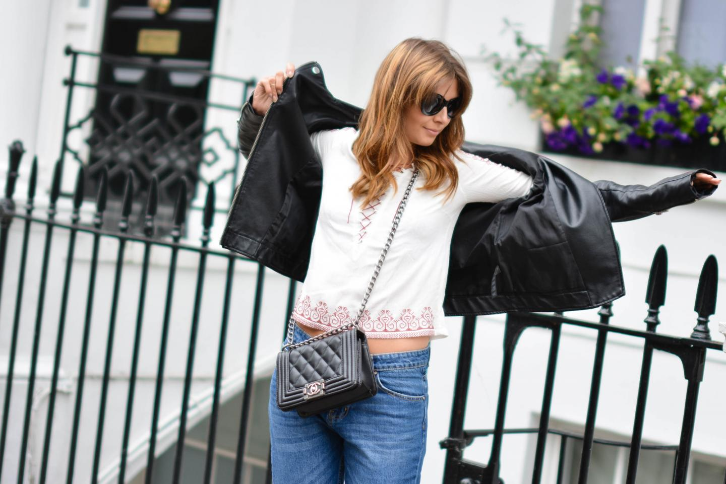 EJSTYLE - Emma Hill wears boohoo boyfriend jeans, leather jacket, embroidered lace up top, chanel boy bag, black cats eye sunglasses, OOTD, festival style
