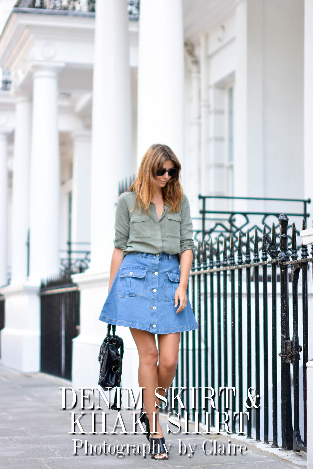 EJSTYLE - Emma Hill wears button up denim skirt with pockets with a khaki shirt, Balenciaga bag, black leasthet mules, heels, how to dress for summer, OOTD, title
