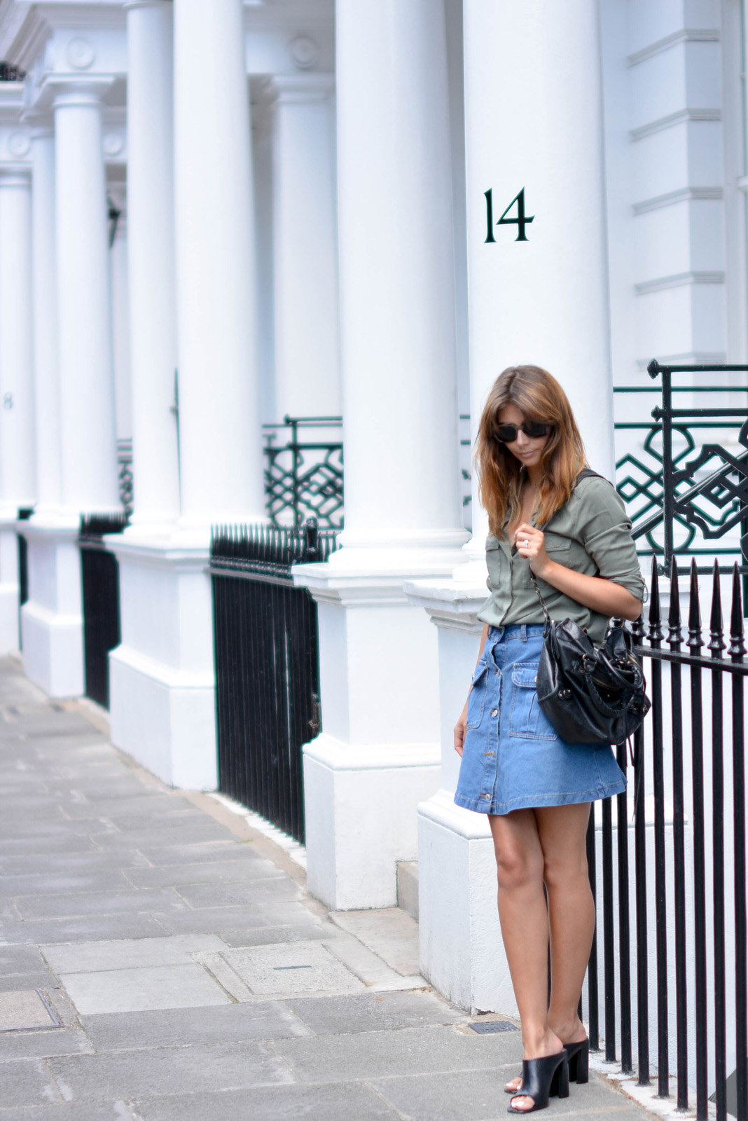 EJSTYLE - Emma Hill wears button up denim skirt with pockets with a khaki shirt, Balenciaga bag, black leather mules, heels, how to dress for summer (2)