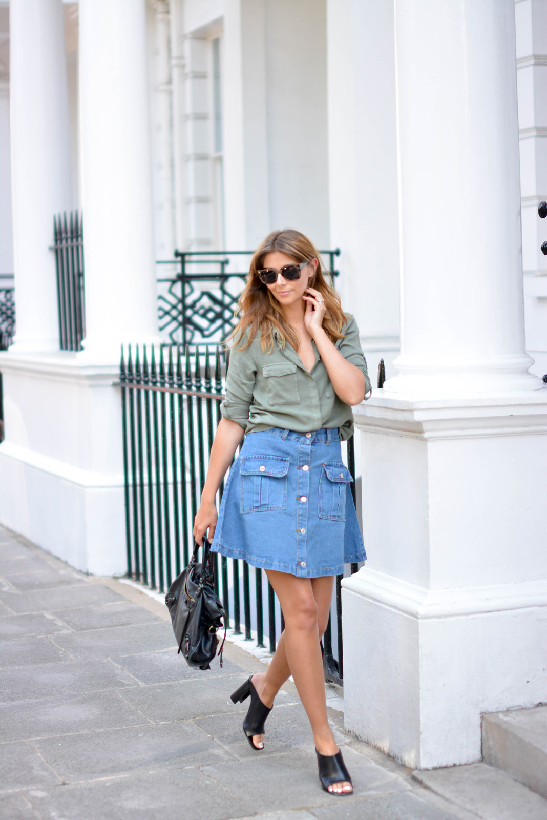 EJSTYLE - Emma Hill wears button up denim skirt with pockets with a khaki shirt, Balenciaga bag, black leather mules, heels, how to dress for summer, OOTD, summer style