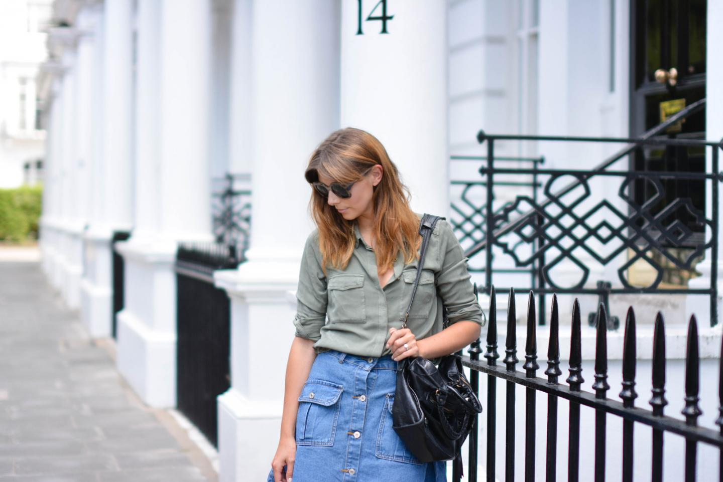 EJSTYLE - Emma Hill wears button up denim skirt with pockets with a khaki shirt, Balenciaga bag, how to dress for summer