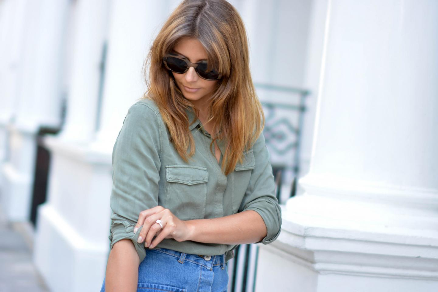 EJSTYLE - Emma Hill wears button up denim skirt with pockets with a khaki shirt and chunky sunglasses, how to dress for summer