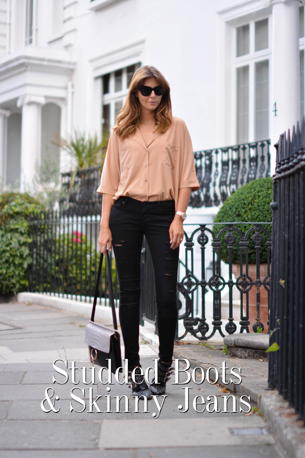 EJSTYLE - Emma Hill wears camel shirt, ripped black skinny jeans, Chloe Faye style bag, black cats eye chunky sunglasses, black studded ankle boots, London Street style, title