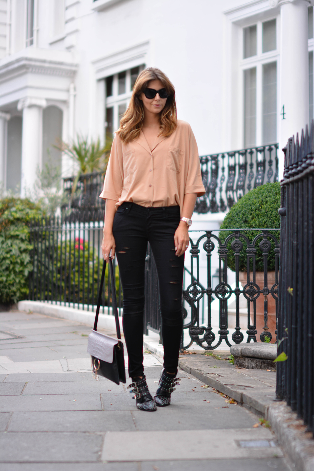 EJSTYLE - Emma Hill wears camel shirt, ripped black skinny jeans, Chloe Faye style bag, black cats eye chunky sunglasses, black studded ankle boots, London Street style