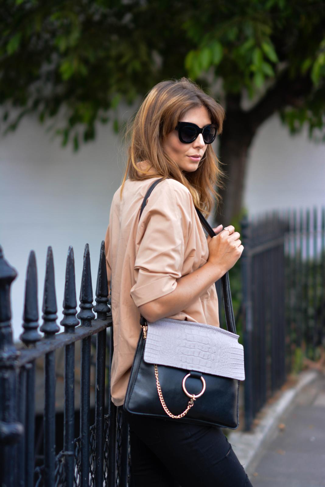 EJSTYLE - Emma Hill wears camel shirt, ripped black skinny jeans, Chloe Faye style bag, black cats eye chunky sunglasses, london street style 2015