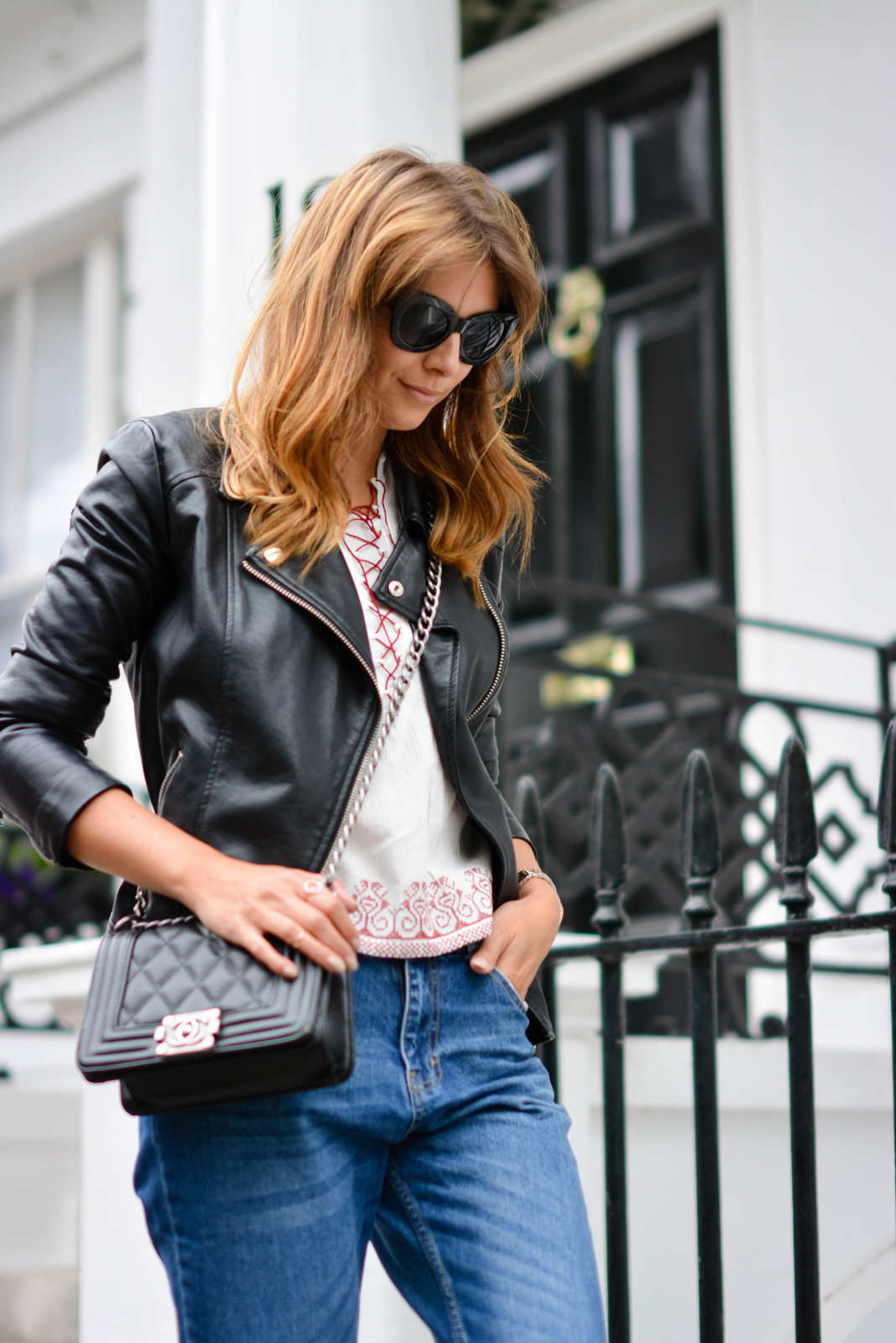 EJSTYLE - Emma Hill wears ripped boyfriend jeans, leather jacket, embroidered lace up top, chanel boy bag, black cats eye sunglasses, OOTD, festival style