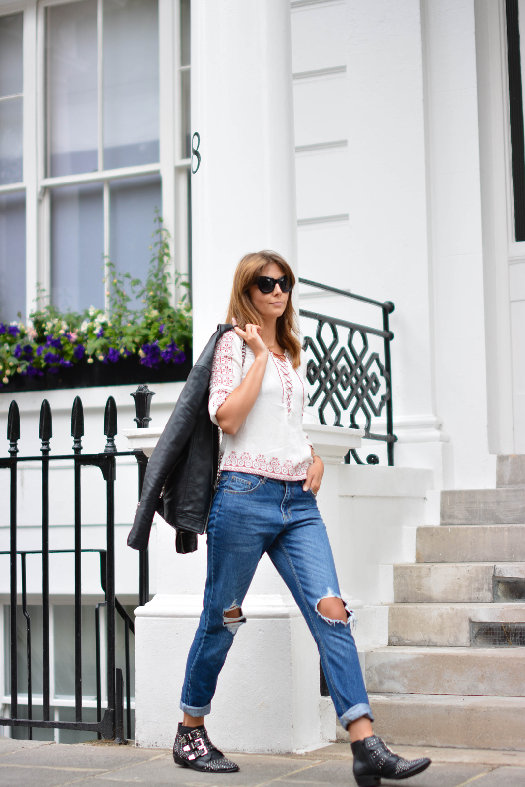 EJSTYLE - Emma Hill wears ripped boyfriend jeans, leather jacket, embroidered lace up top, chanel boy bag, studded black ankle boots, black cats eye sunglasses, OOTD, street style