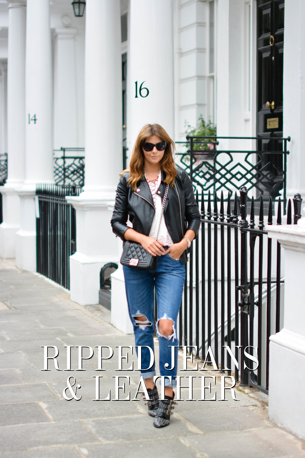 EJSTYLE - Emma Hill wears ripped boyfriend jeans, leather jacket, embroidered lace up top, chanel boy bag, studded black ankle boots, black cats eye sunglasses, OOTD, title