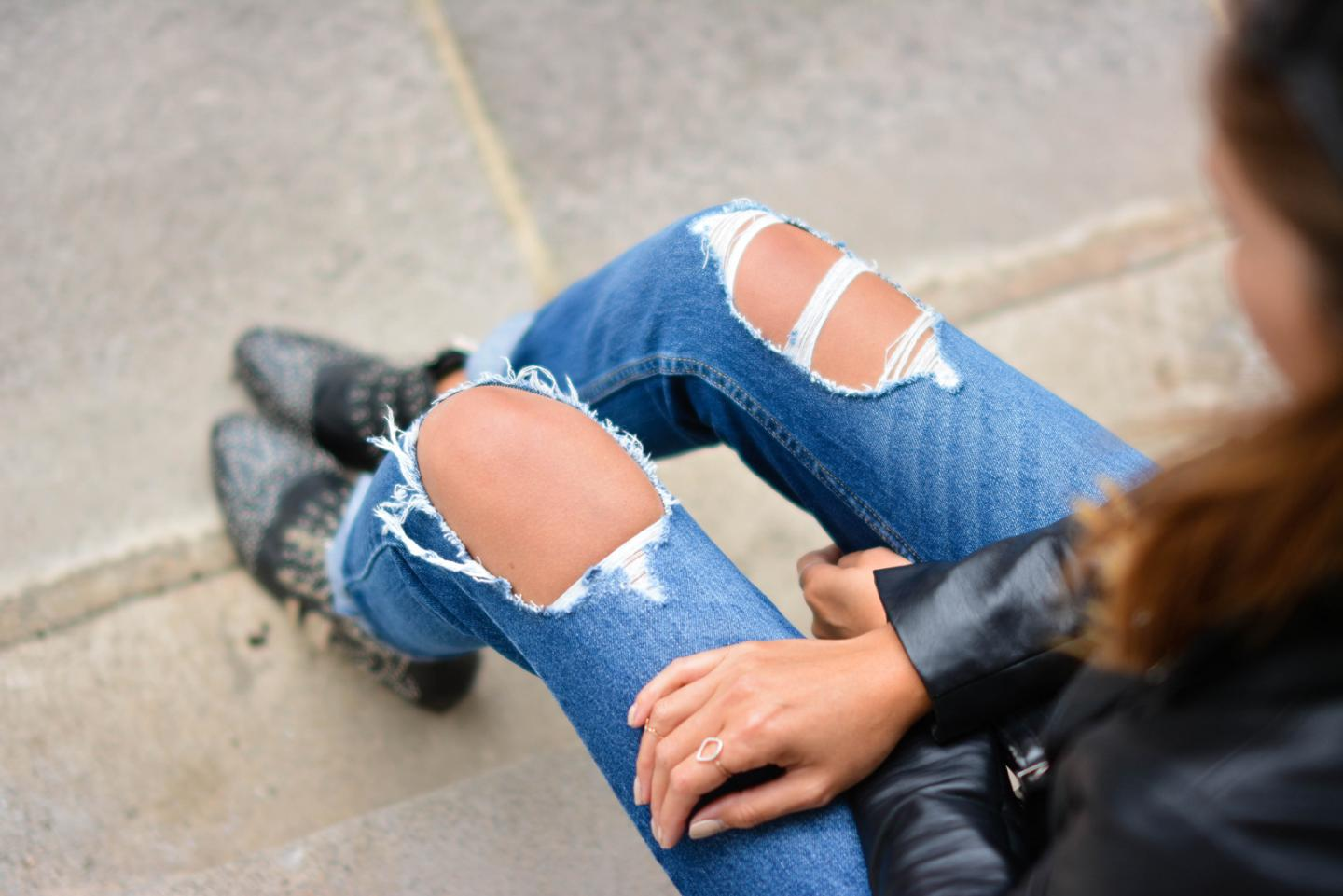 EJSTYLE - Emma Hill wears ripped boyfriend jeans, leather jacket, studded black ankle boots, OOTD